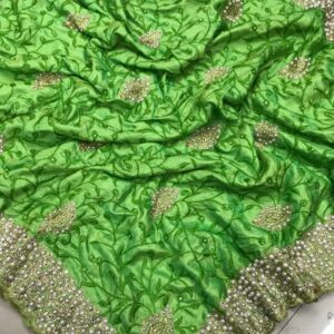 Green Colored Sana Silk Saree And Silk Unstitched Blouse