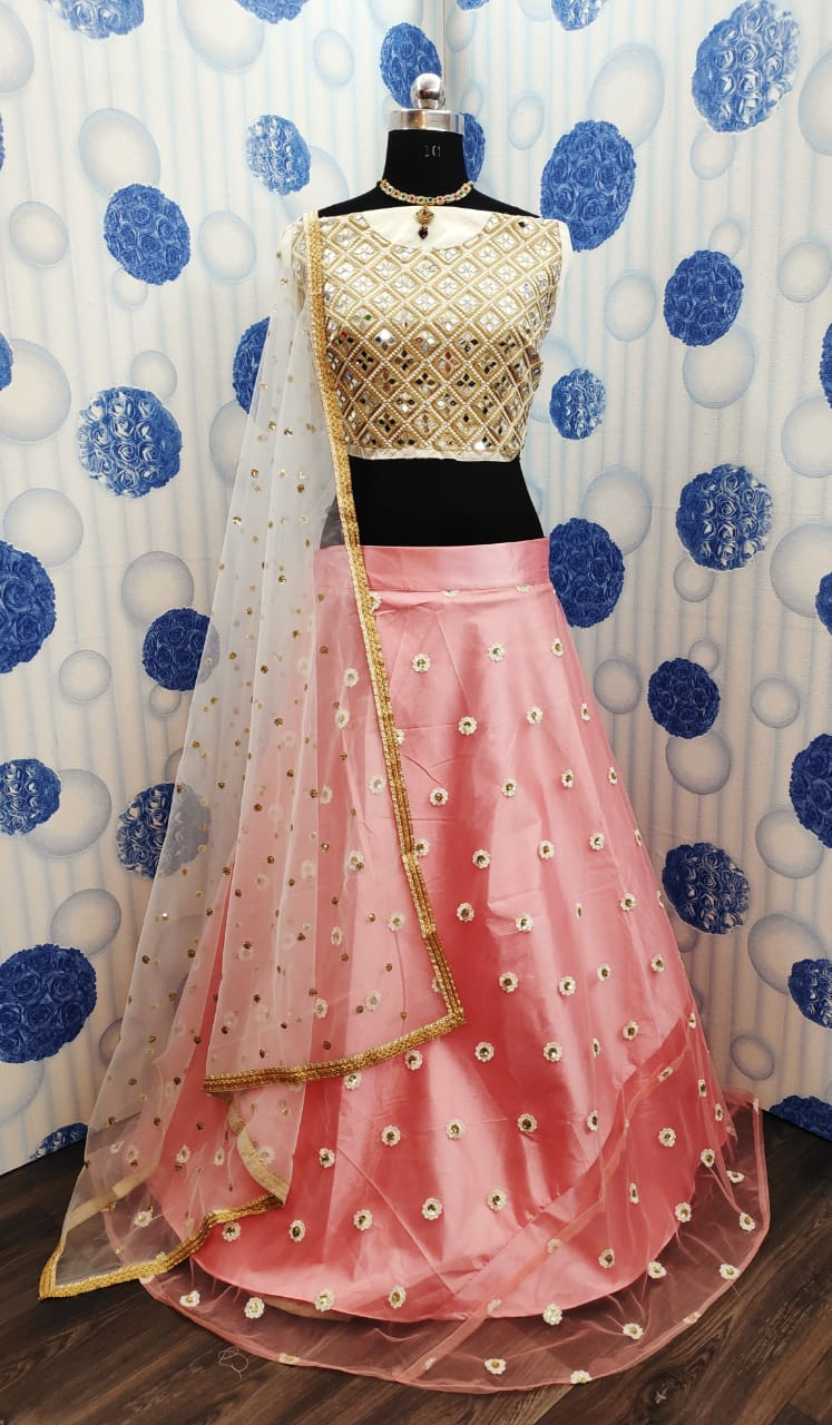 Staggering Cream & Peach Net With Embroidered Mirror Work Online Lehenga Choli Design