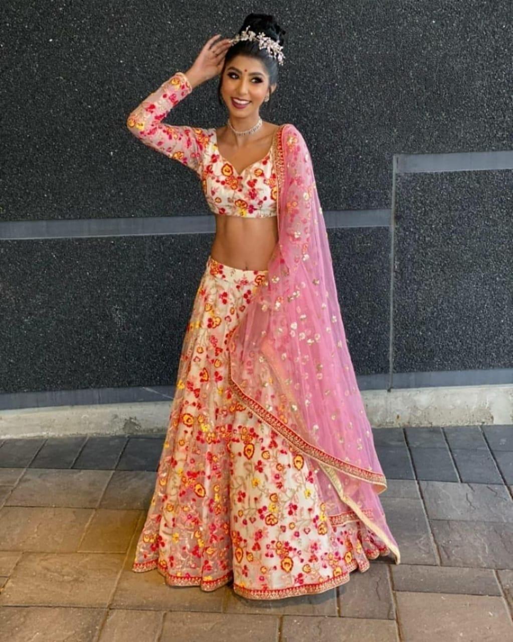 Pulchritudinous Pink & Off White Net With Embroidered Work Lehenga Choli