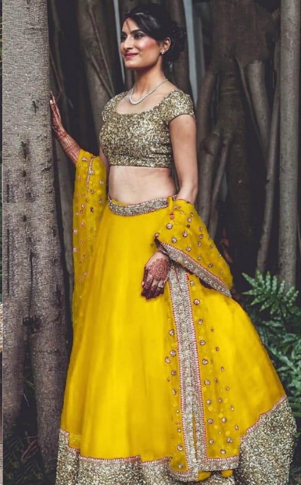 Beautiful Yellow Net With Sequence Work Lehenga Choli